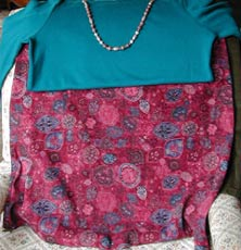 rhodonite necklace on teal sweater