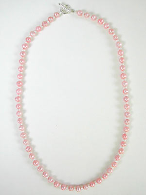 white and pink pearl necklace