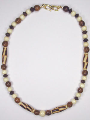 brown and beige necklace with burnt wood rice