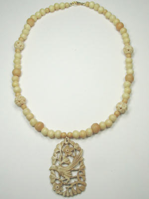 handmade bone necklace with carved pendant