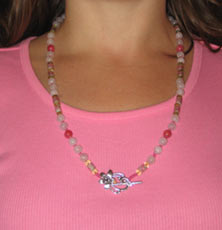 pink necklace on pink