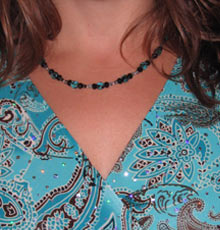 aqua necklace on aqua print