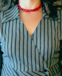 short red necklace with black stripe