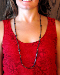black millefiori necklace on red print
